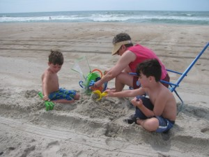 The boys building sand castles with Granny Annie