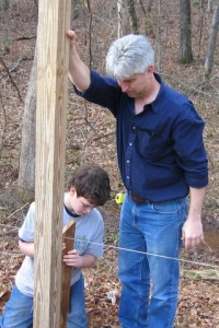 Phil guides a student through a building project in the early days of Cherokee Creek