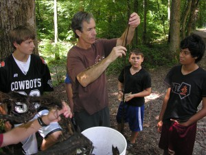 Mark Warren determines appropriate bark for making cordage.