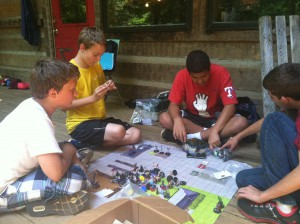 Tommy, Gerhardt, Michael and Perry start a game of Heroclix