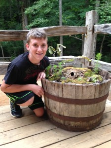Sam with his gnome garden at Cherokee Creek Boys Boarding School